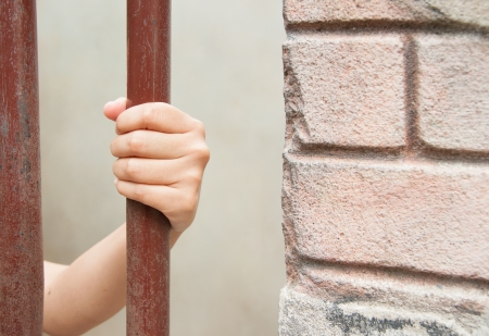 waiting convict: hand in jail. Stock Photo