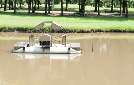 waterwheel: The Chaipattana Low Speed Surface Aerator Model RX-2 designed and developed by his Majesty the King Bhumibol Adulyadej of Thailand, Thia one in a small lake in Jatujak park in Bangkok, Thailand.