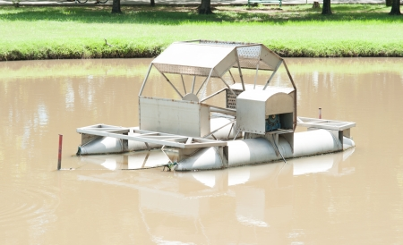 aeration: The Chaipattana Low Speed Surface Aerator Model RX-2 designed and developed by his Majesty the King Bhumibol Adulyadej of Thailand, Thia one in a small lake in Jatujak park in Bangkok, Thailand.