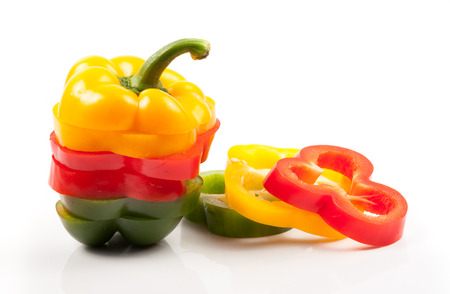 Colorful sliced bell pepper. Isolated on white background photo