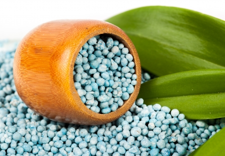Blue fertilizer on white background photo