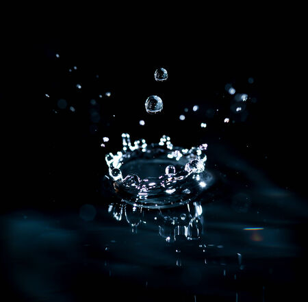 brilliant drops transparent water on black