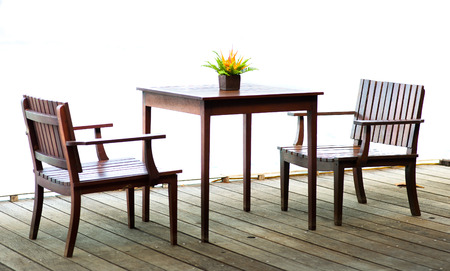 wood chairs and table photo