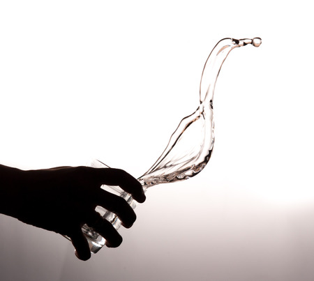 hands with glass and water splashing photo
