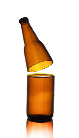 dewed: Cut Glass of beer on white background