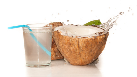 water s: Coconut with water splash over white