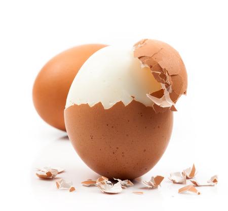 peeled boiled egg on white background