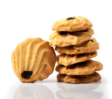 Oatmeal cookies with raisin on a white background photo