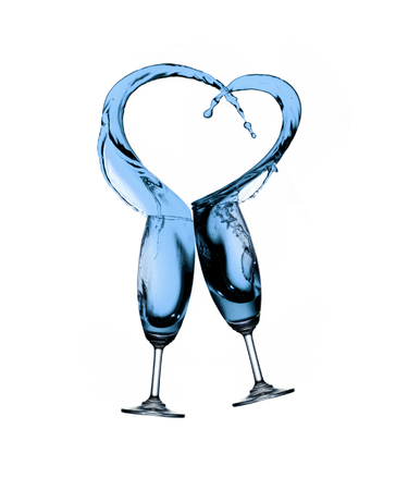 Water splash from two glasses in heart photo