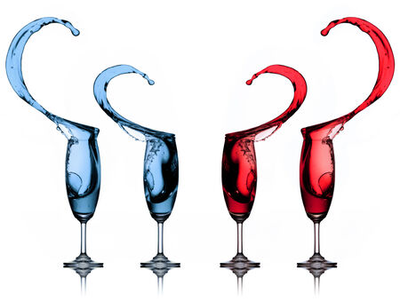 water splash in wine glasses isolated on white photo