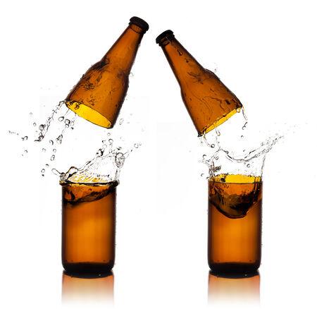 Beer bottle cut  and water splash photo