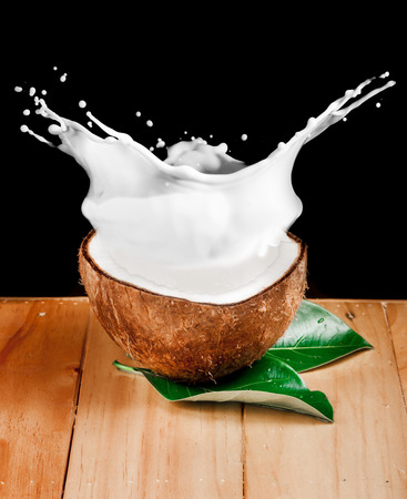 walnut coconut milk on wood photo
