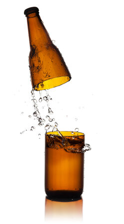 Beer bottle cut  and water splash photo