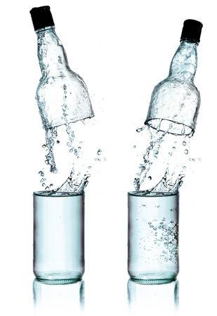 Fresh water splashing out of bottle, isolated on white background photo