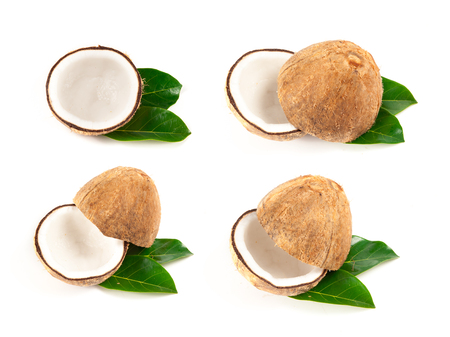 Coconut with green leaves isolated on white photo