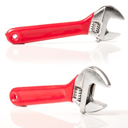 Red and Silver Metal Monkey Wrench Isolated On White Background. photo
