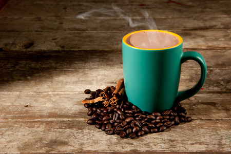 cup of hot coffee on wood background photo