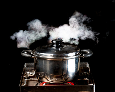 steam over cooking pot photo