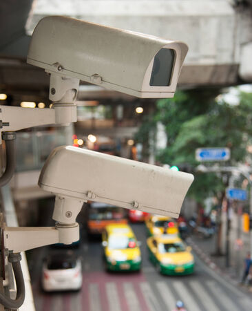 CCTV Camera Operating on road detecting traffic photo