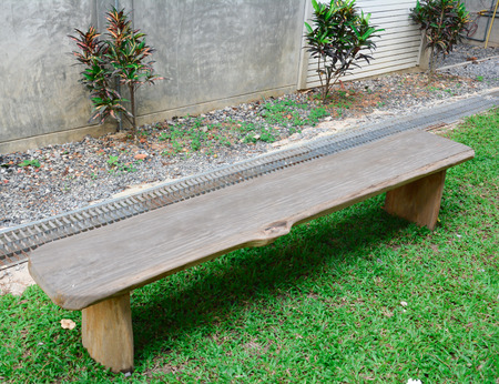 timber bench seat: Wooden park bench in nature. A good place to sit Stock Photo