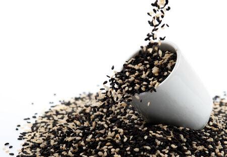 white sesame seeds: black and white sesame seeds isolated
