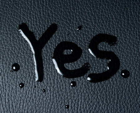 The word YES on black skin photo