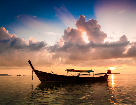 Boat in Sunset at Kho Lipe, Thailand photo