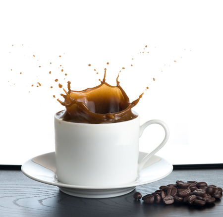 splash coffee isolated on white background photo