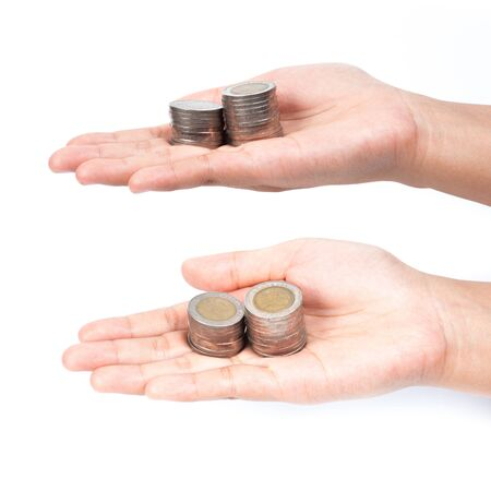 picture of two hands full of coins over white background photo