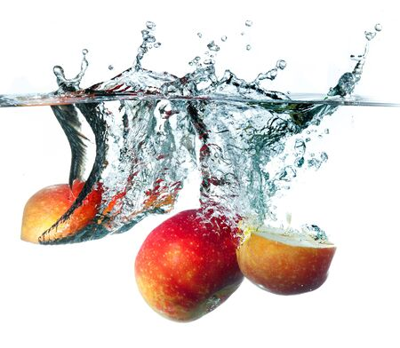dropping: Apple dropping into water