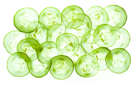 Fresh Cucumber and slices white background photo