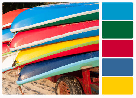 Colorful plastic boats on a rack ashore , colour palette swatches. photo