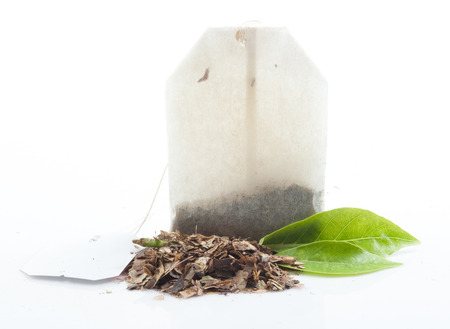 Tea bag with leaves isolated on white background Stock Photo