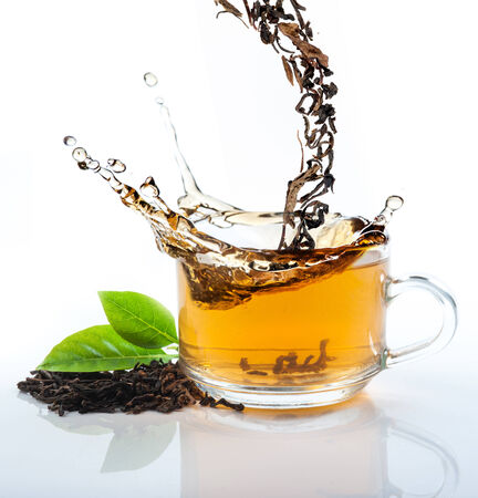 Tea flowing in cup photo