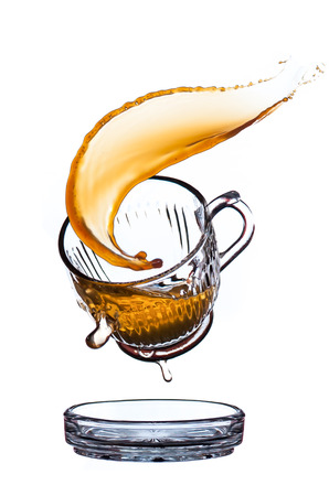 Splash coffee in glass cup, isolated on white background. photo