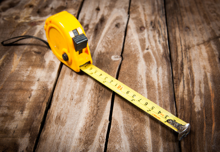 tape measure on the  wooden background