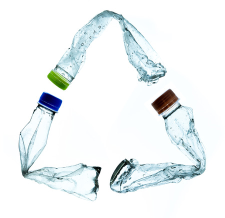 close up of an empty used plastic bottle on white background photo