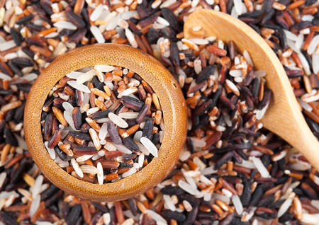 black rice: Food background with of rice variety . rice mixture. brown rice, black rice, white rice.
