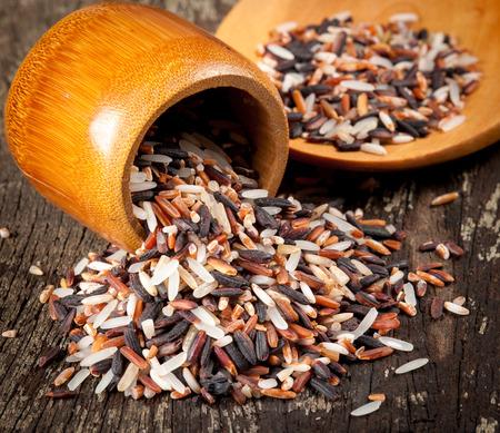 variety of rice on wood photo