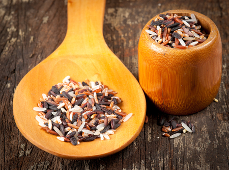 rice mix in a wooden spoon photo