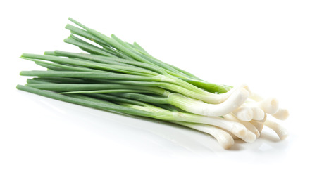 Cut green onion isolated on the white background