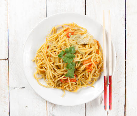 noodles and vegetables on wood photo