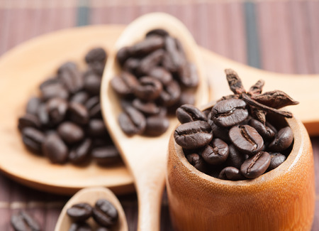 Coffee bean with wooden spoon photo