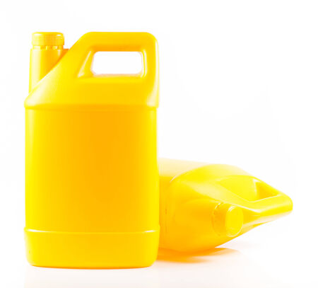 Yellow plastic container isolated on a white background. photo