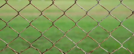 iron wire fence isolated on green background photo