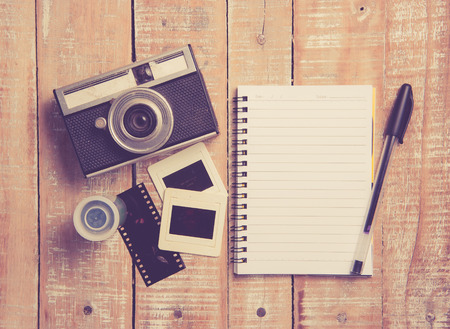old diary: Old camera and film with diary on a wooden,vintage color toned image Stock Photo