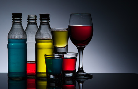 Exotic bottle alcohol cocktail and glass  photo