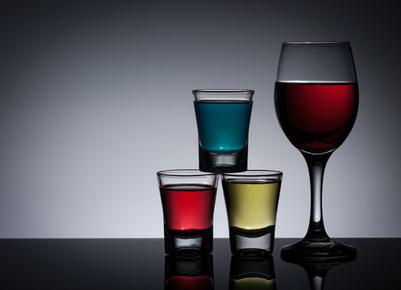 cocktail and glass on dark background photo