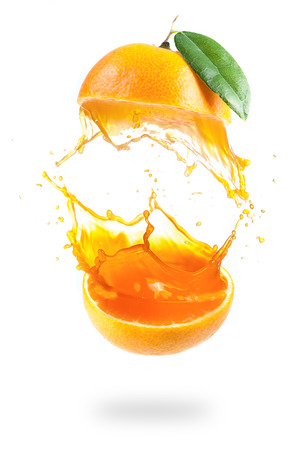 Orange juice splashing isolated on white
