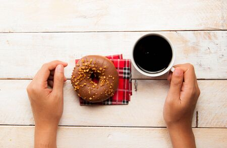donuts and coffee on the wood background photo
